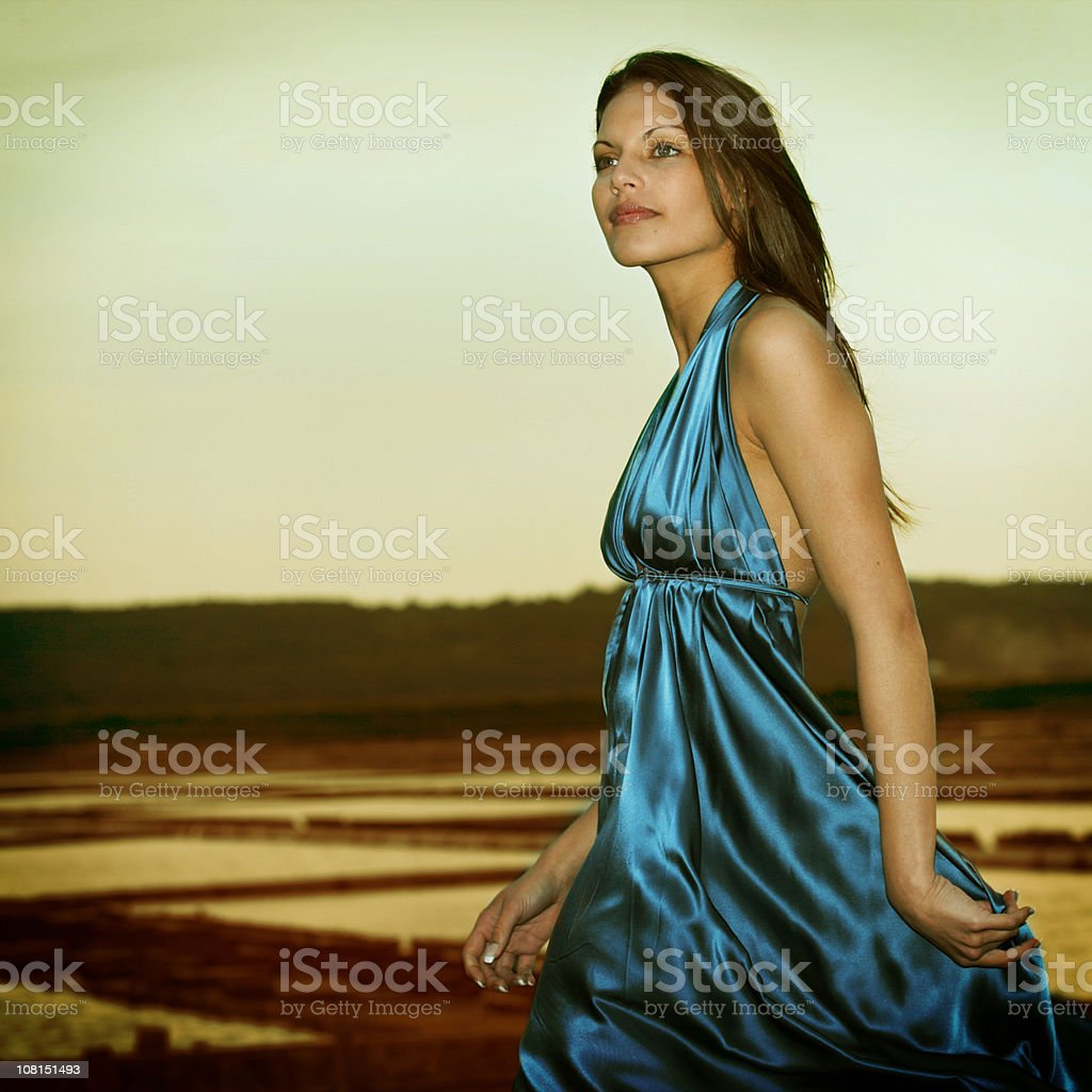 Portrait of Young Woman with Slovenian Salterns in Background royalty-free stock photo