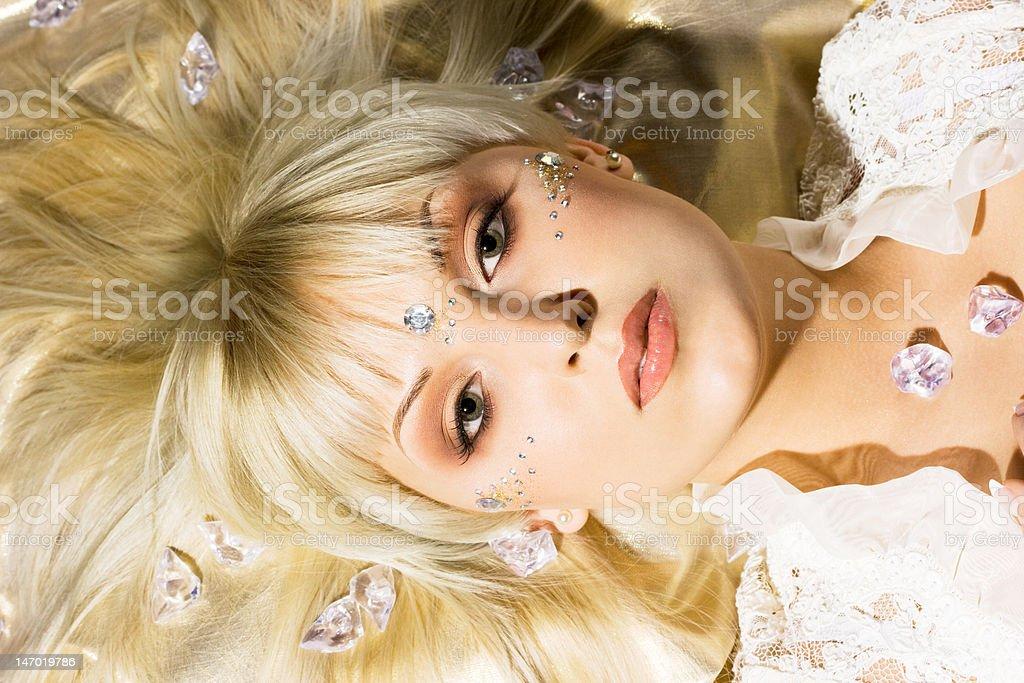 Retrato de jovem com strasses na face foto de stock royalty-free