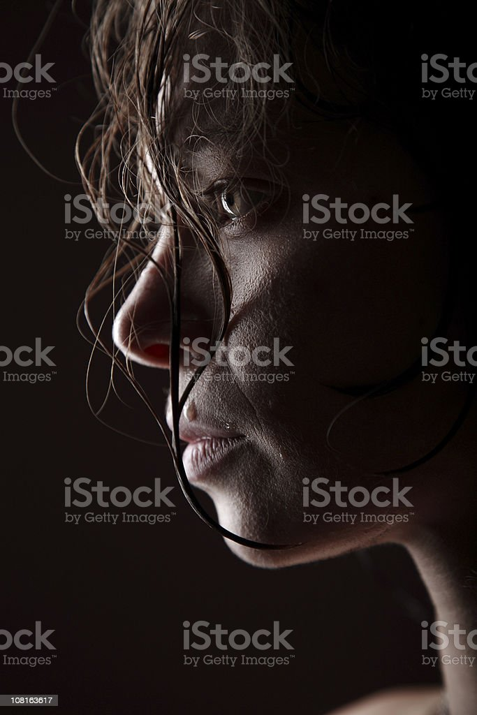 Portrait of Young Woman with Wet Hair, Low Key stock photo