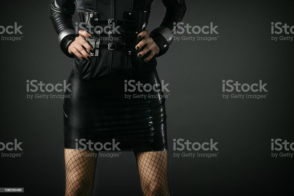 Portrait of Young Woman's Waist in Latex Dress royalty-free stock photo