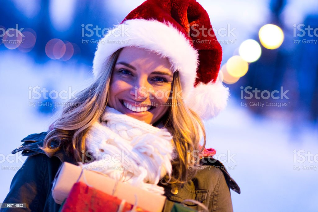 Portrait of young womanwith Santa's hat stock photo