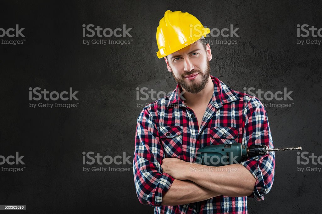 Portrait of young workman with drill stock photo