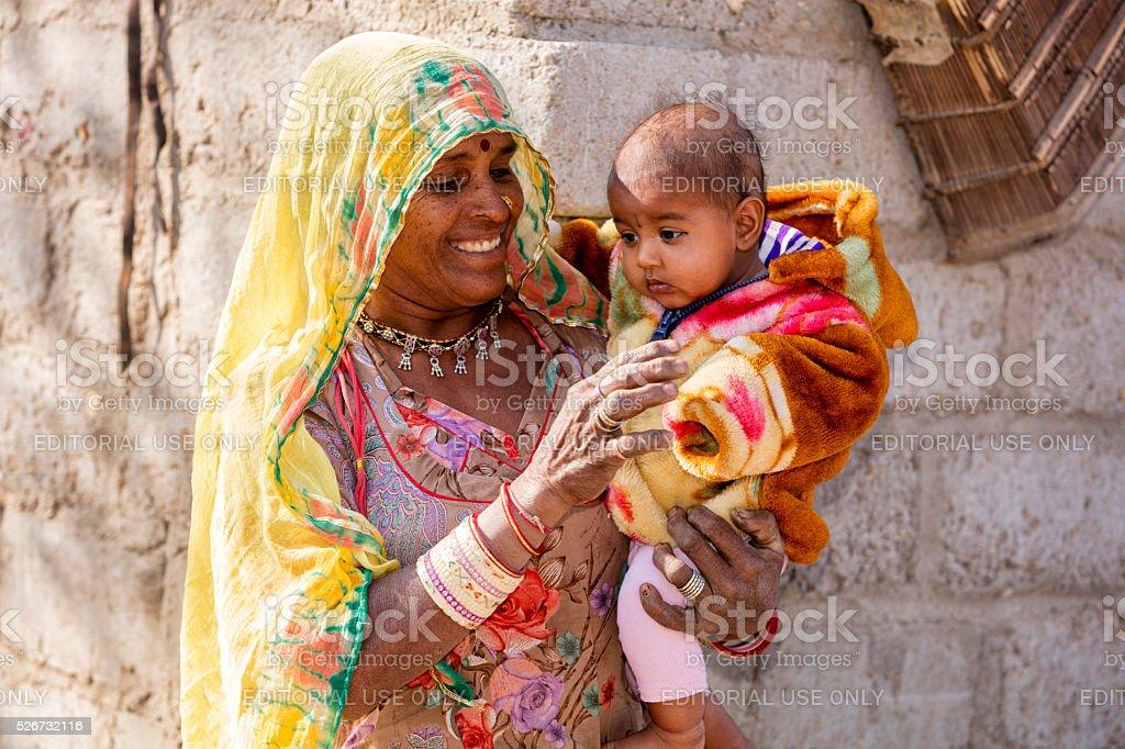 Portrait ofIndian woman with small child, Bishnoi, Jodhpur, Rajasthan, India stock photo
