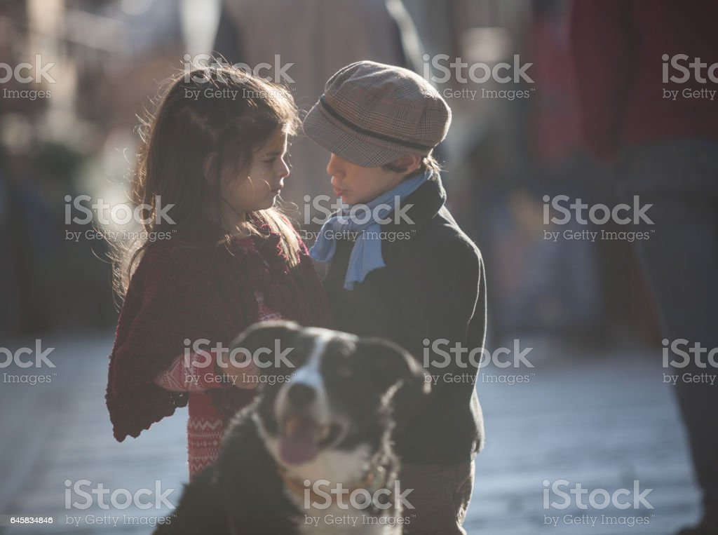 Portrait OfLittle Girl And Boy Looking Each Other stock photo