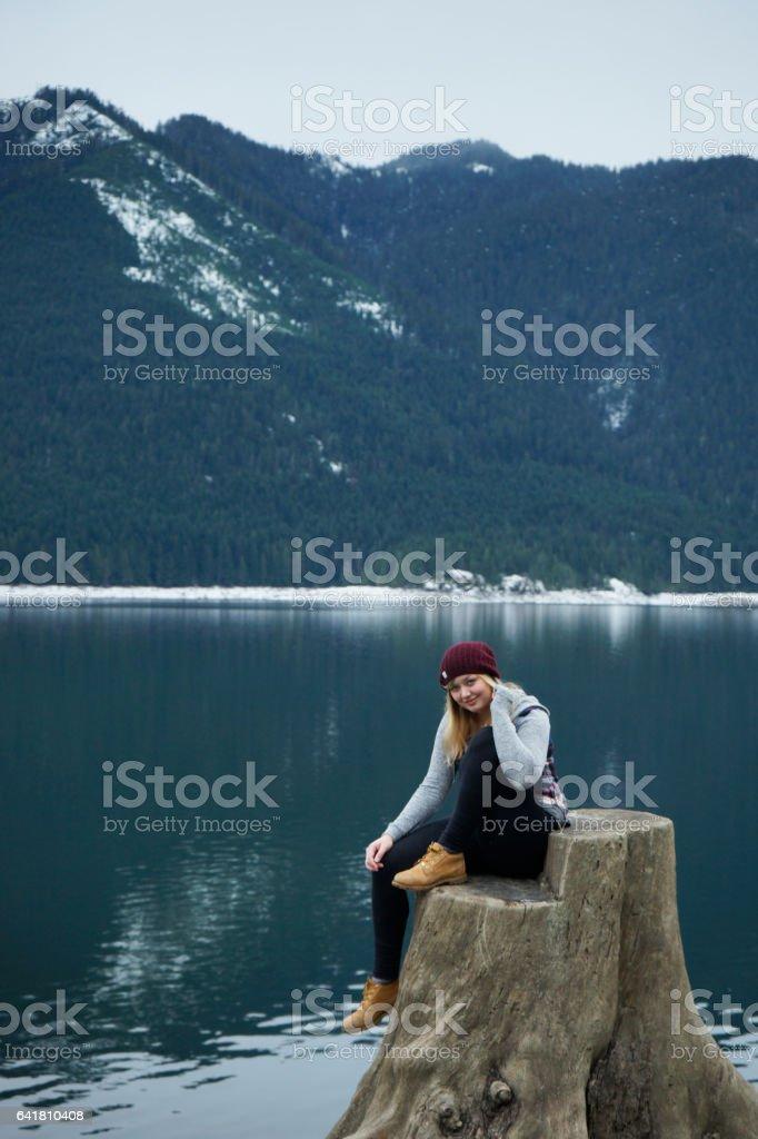 portrait on tree stump near the lake stock photo