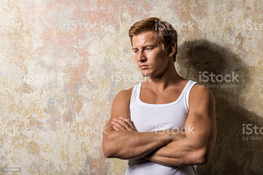 portrait one sad man standing near a wall stock photo
