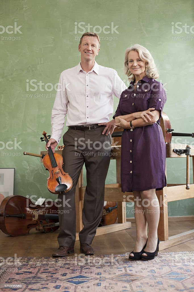 Portrait owners of a violin shop stock photo