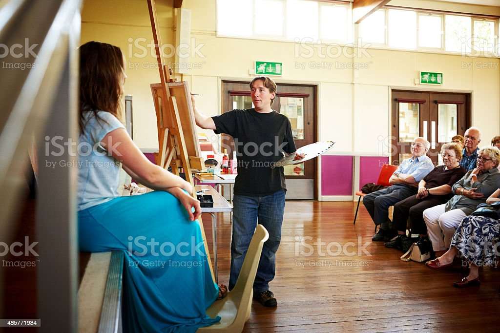 Portrait painting demonstration to audience stock photo