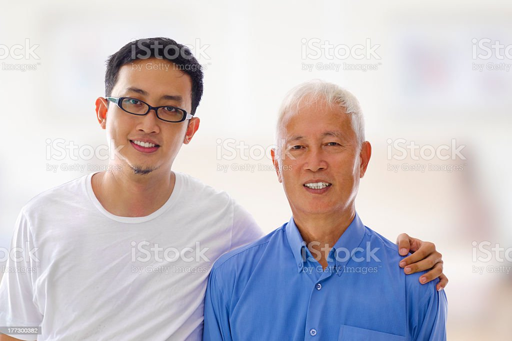 Portrait photo of oriental father and son smiling to camera stock photo