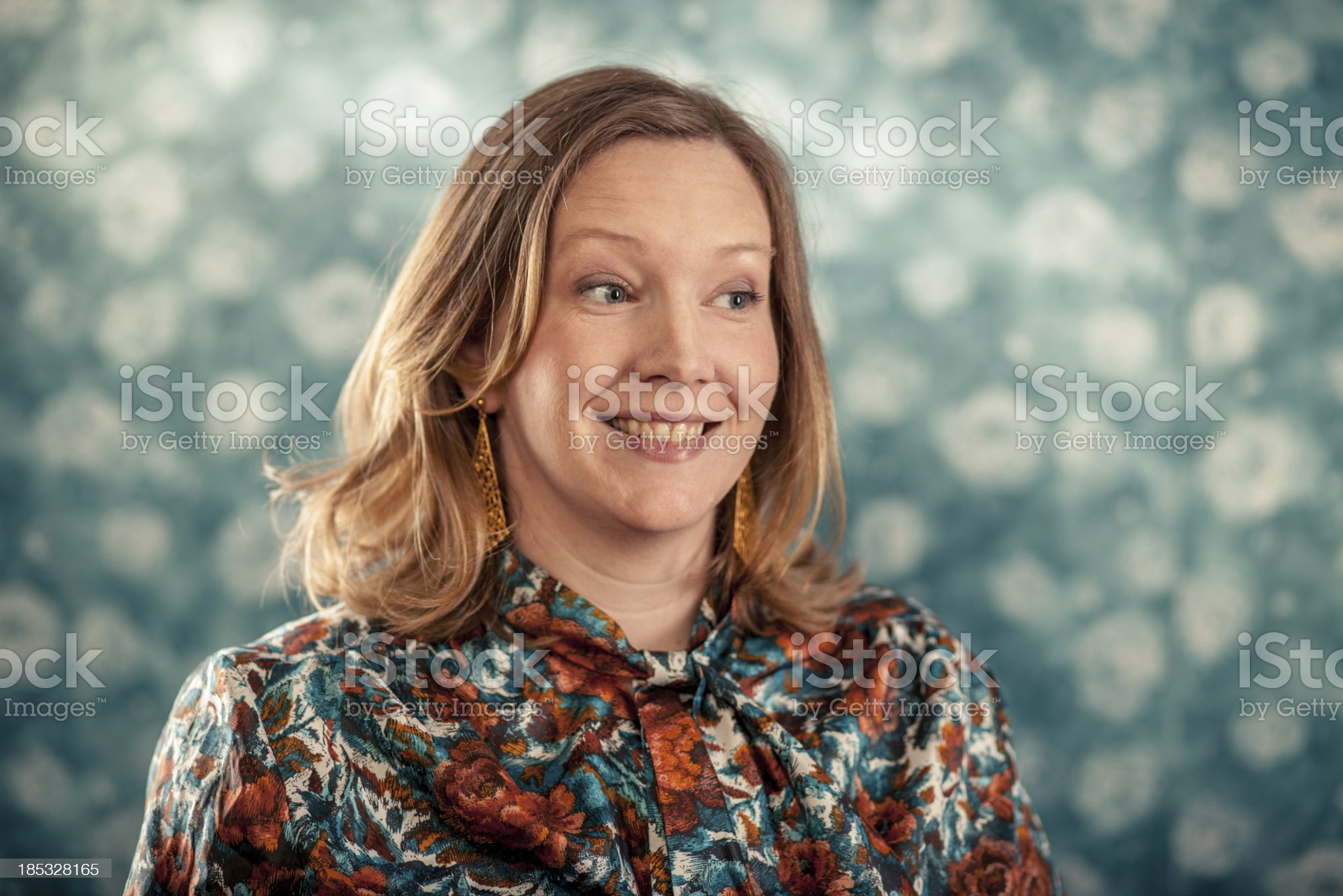 Portrait Photograph of Blond Woman Wearing Flowery Blouse royalty-free stock photo
