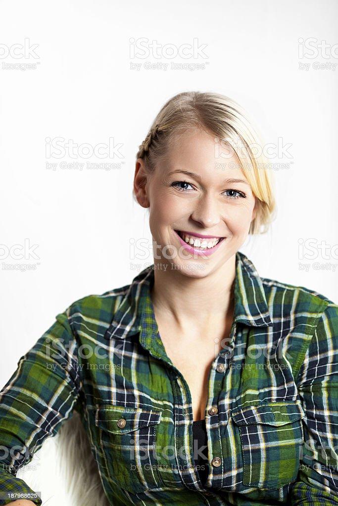 portrait pretty of blond woman in green lumberjack shirt stock photo