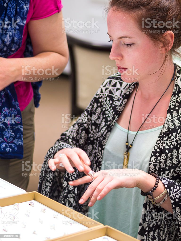 Portrait profile of young beautiful tourist looking at rings stock photo