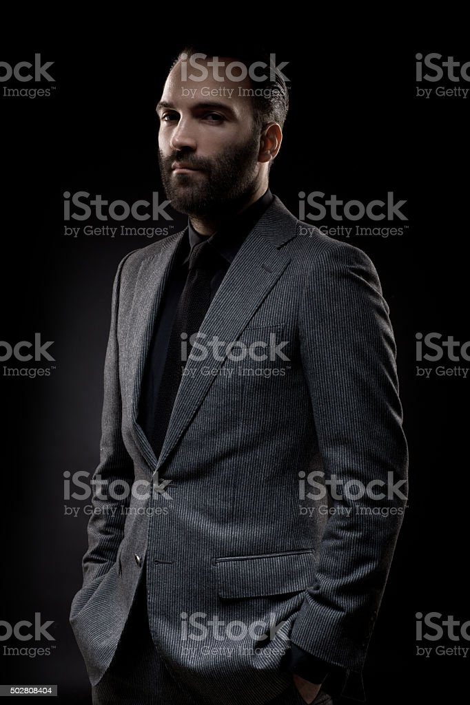 Portrait profile picture of a stylish bearded gentleman stock photo