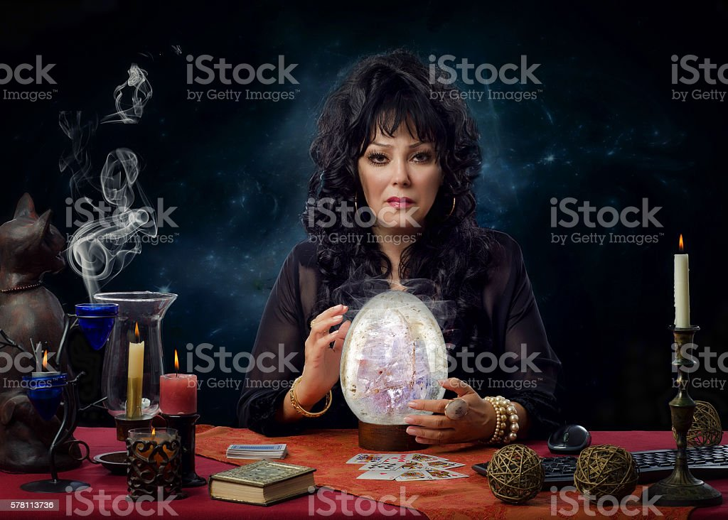 Portrait psychic with big crystal egg stock photo