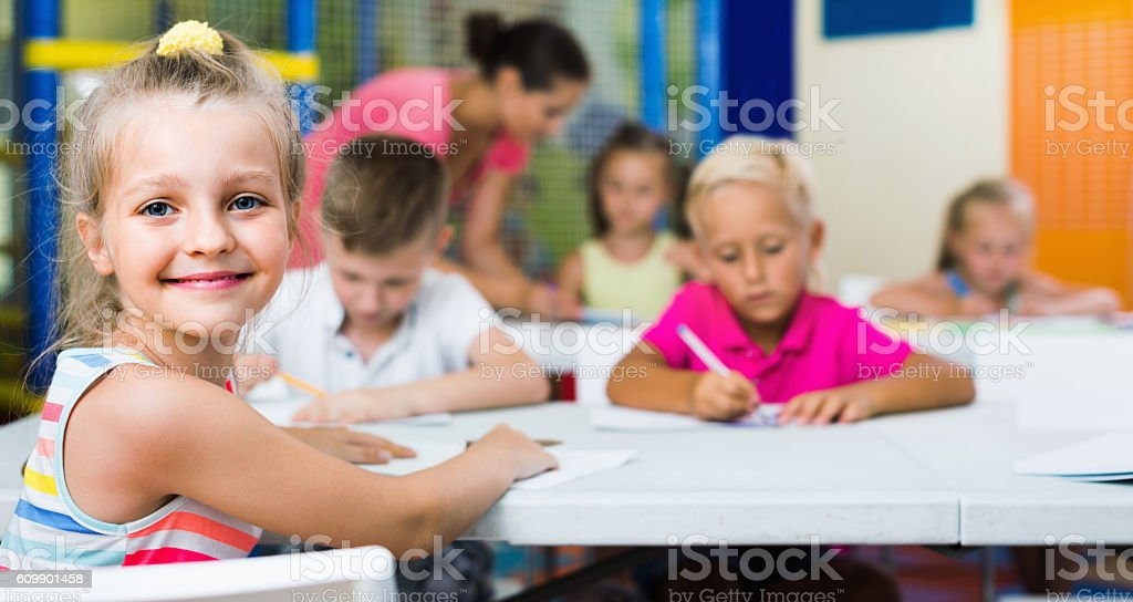 Portrait  pupil girl studying in school class stock photo