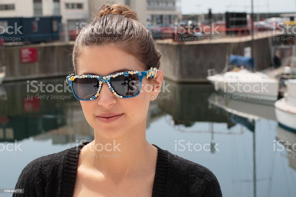 Portrait Russian outdoor girl with sunglasses Brighton Marina stock photo