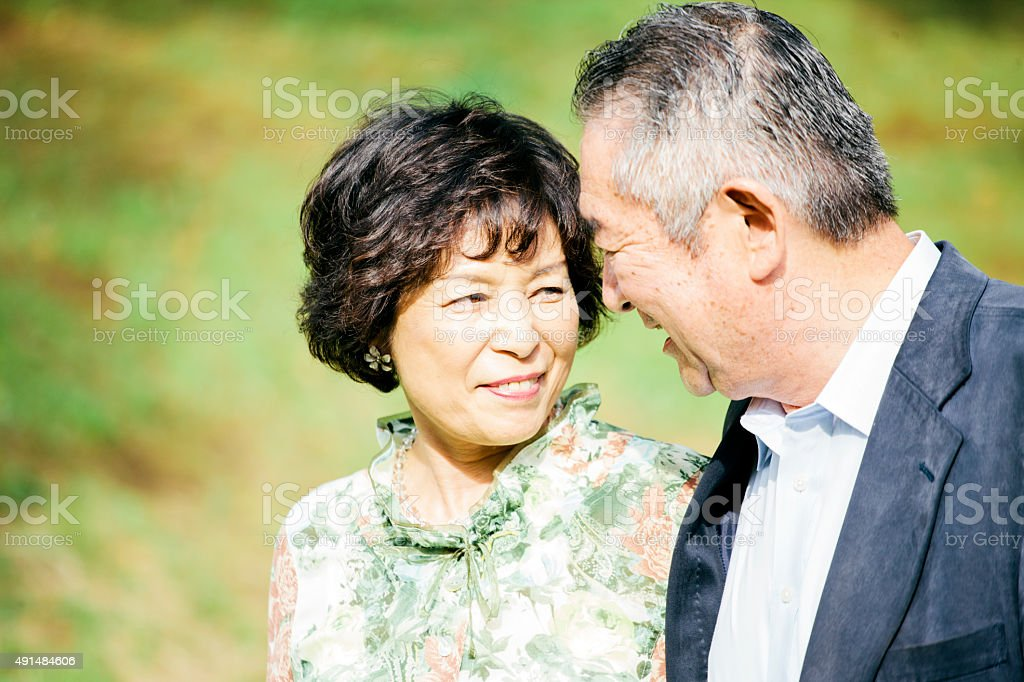 Portrait, senior couple walk together in Yoyogi Park, Tokyo, Japan stock photo