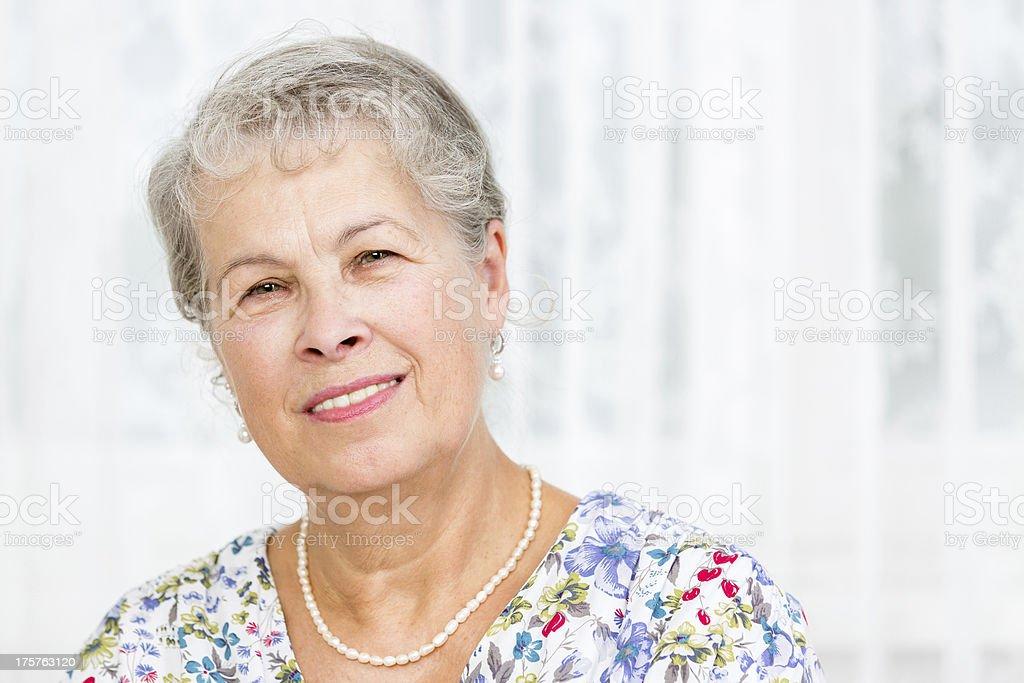 Portrait senior woman at home royalty-free stock photo