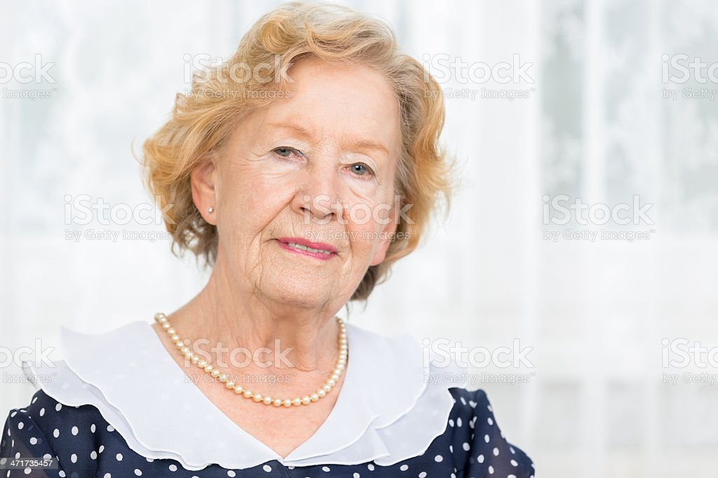 Portrait senior woman at home royalty-free stock photo