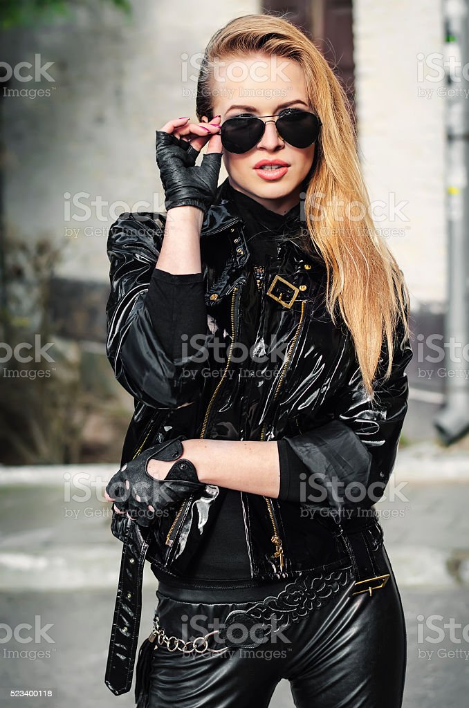 portrait sexy biker woman in black jacket stock photo