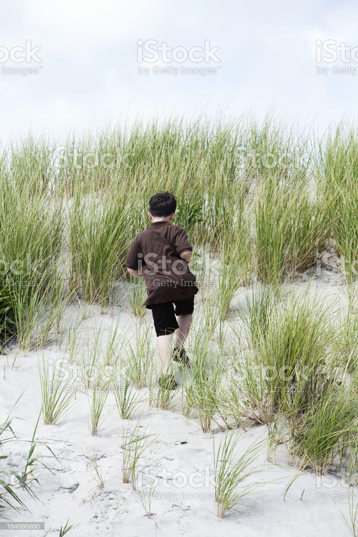 Portrait shot of boy on sand dune royalty-free stock photo