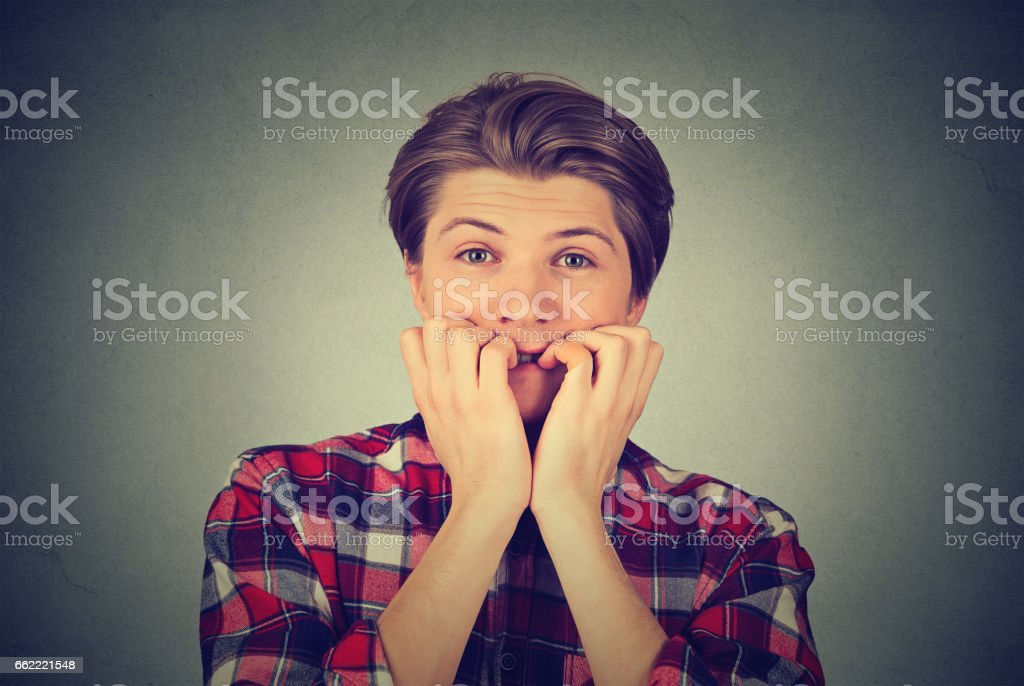 Portrait stressed young handsome man with neck pain stock photo