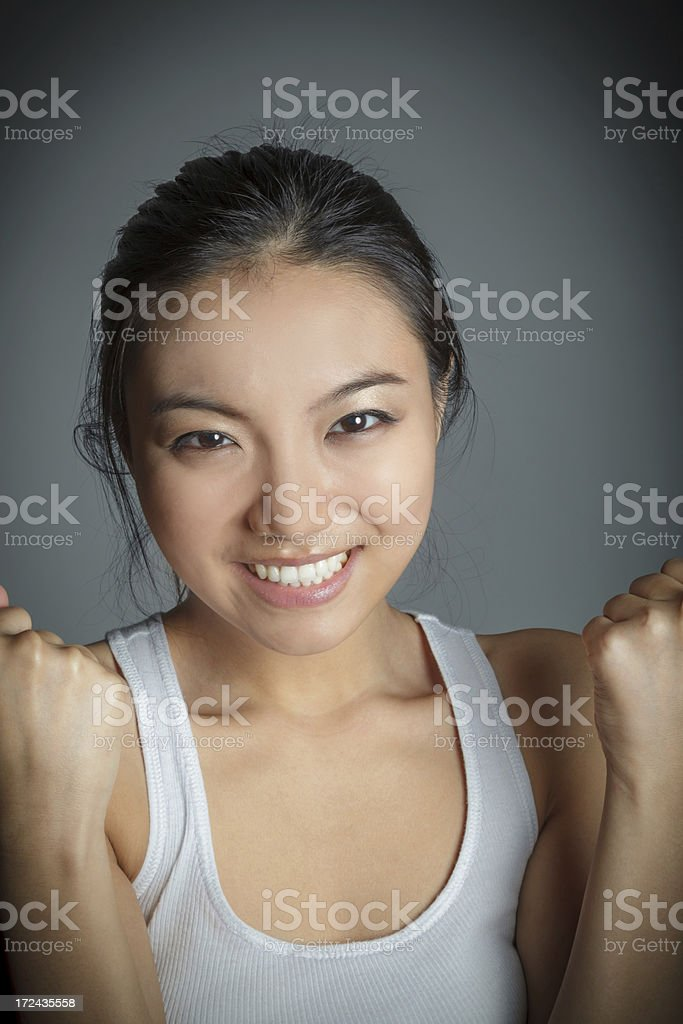 Portrait Tank top attractive asian girl isolated on grey royalty-free stock photo