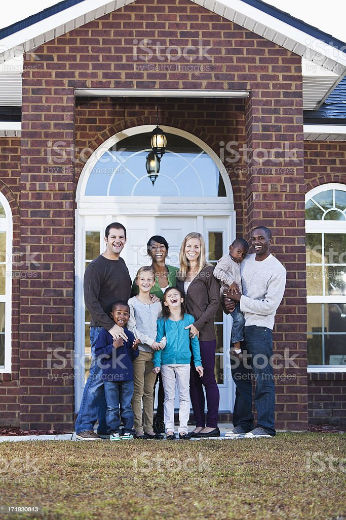 Portrait two families in front of house stock photo