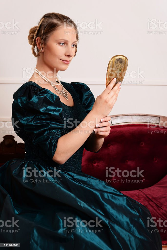 portrait victorian woman with mirror stock photo