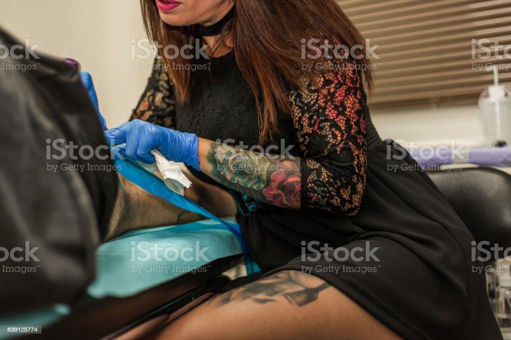 Female Tattoo Artist At Work