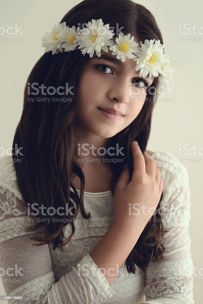 portrait young girl with flowers in hair stock photo