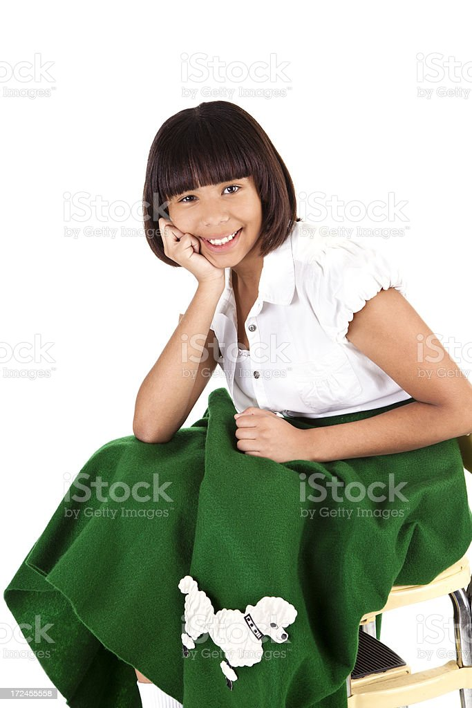 Portrait:  Young teenager in 1950s poodle shirt fashion. stock photo