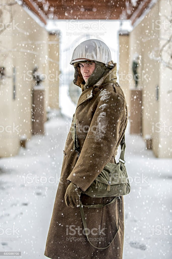 Portraits of a WWII Infantryman in the Snow stock photo