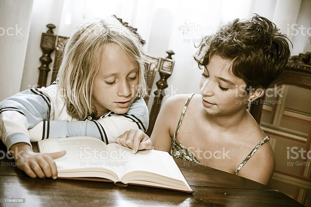 Portraits of young childs reading a book royalty-free stock photo
