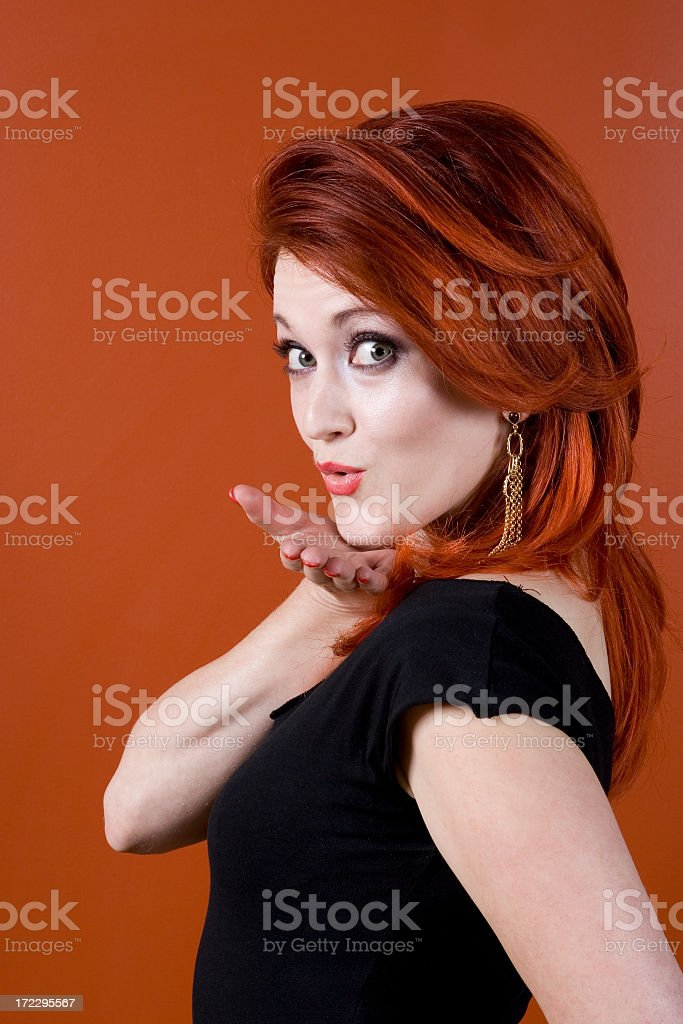 Portraits on Orange-Beautiful Red Haired Woman royalty-free stock photo
