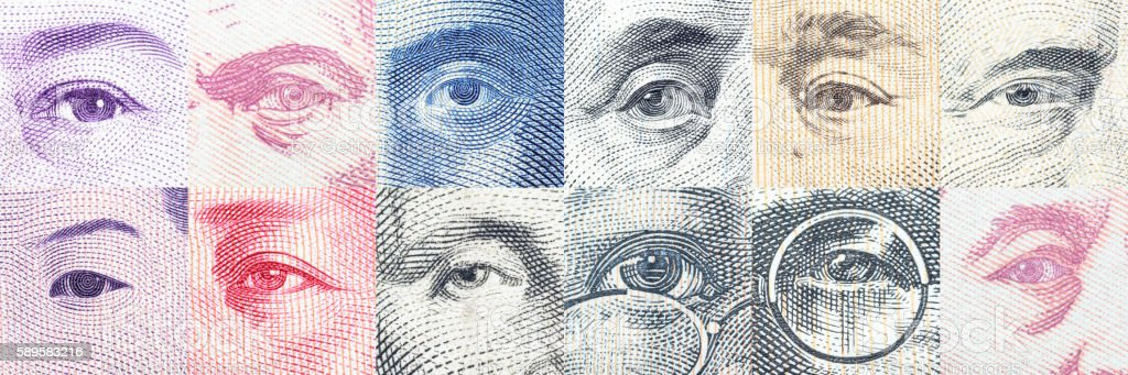 Portraits / the eyes of famous leader on banknotes. stock photo