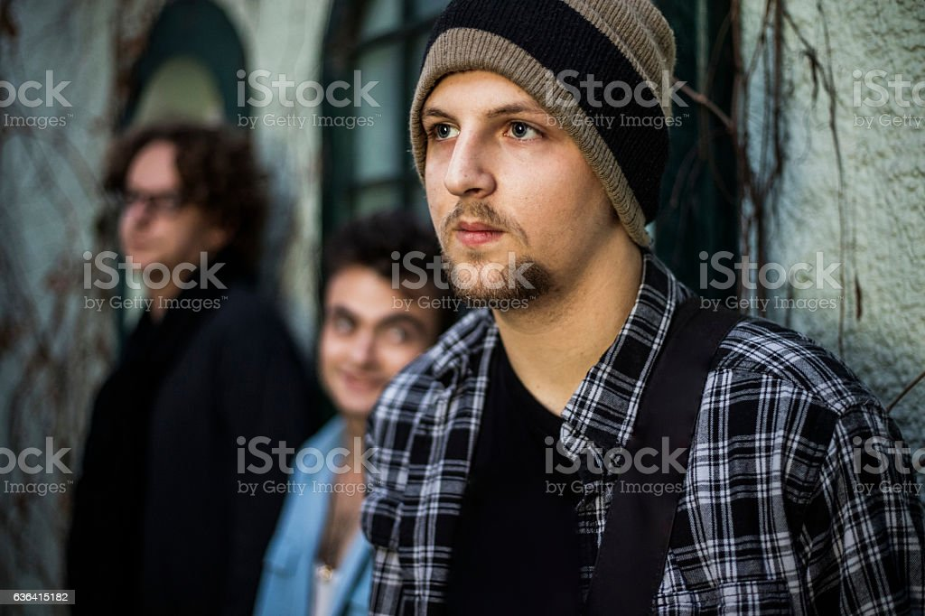 Portraiture of caucasian musicians in rock band stock photo