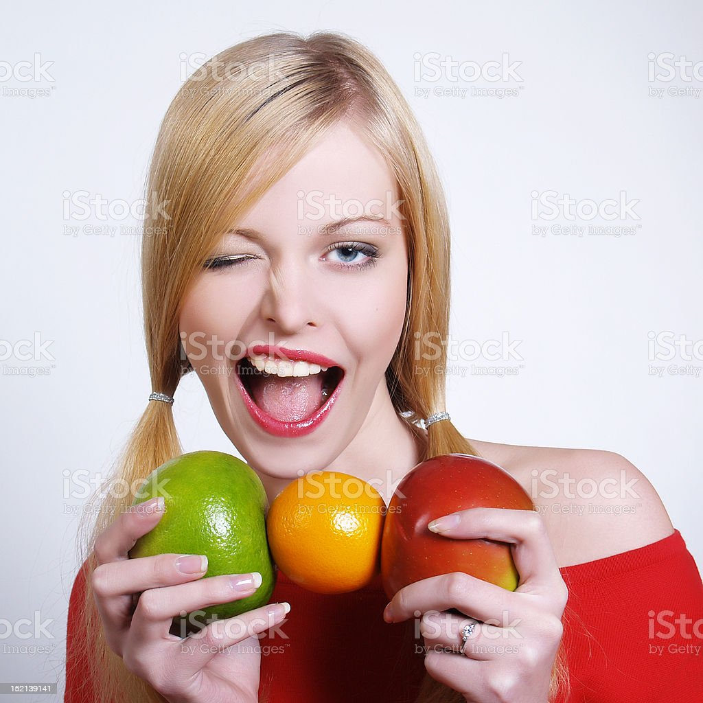 Portrate of beautiful girl with the fruits royalty-free stock photo