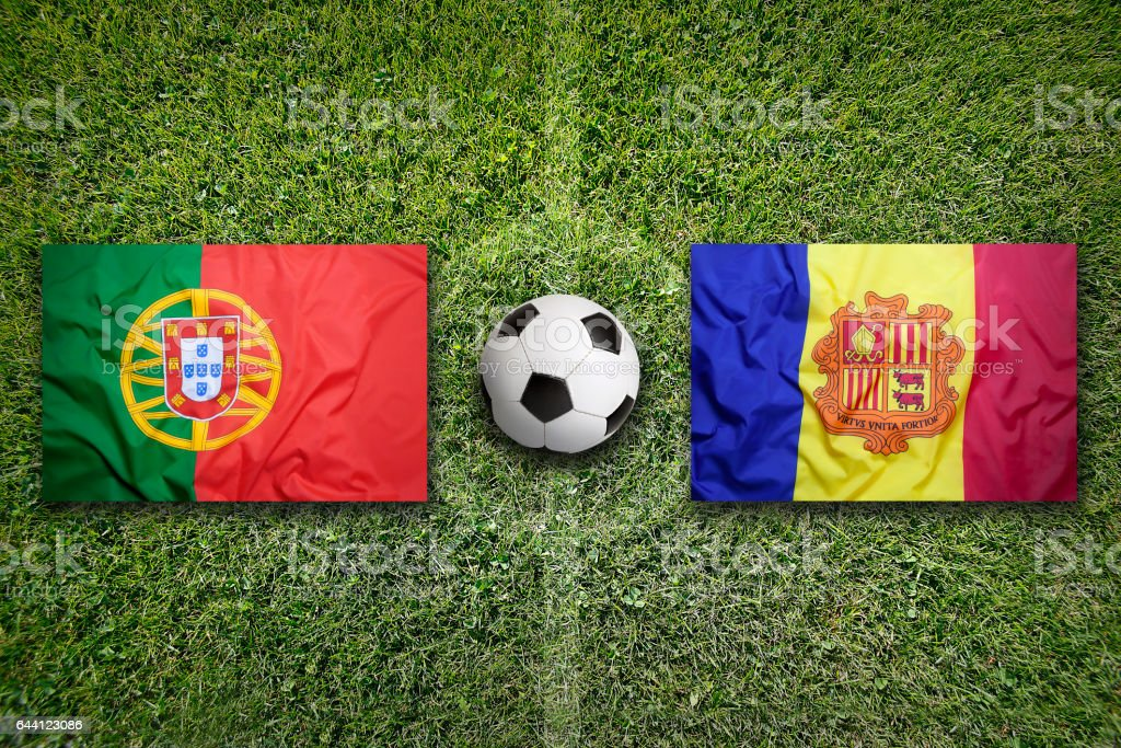 Portugal and Andorra flags on soccer field stock photo