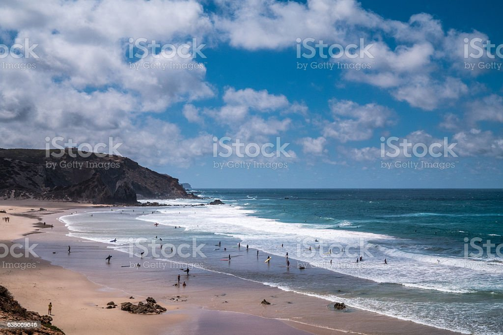 Portugal - Sunbathing under clouds on the beach stock photo