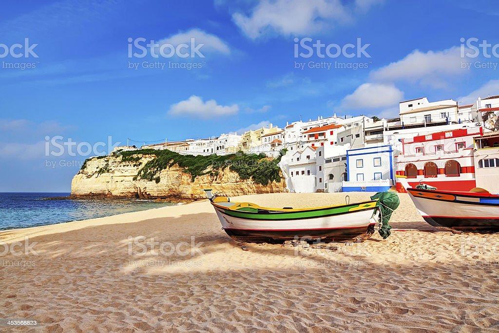 Portuguese beach villa in Carvoeiro classic fishing boats. Summe stock photo