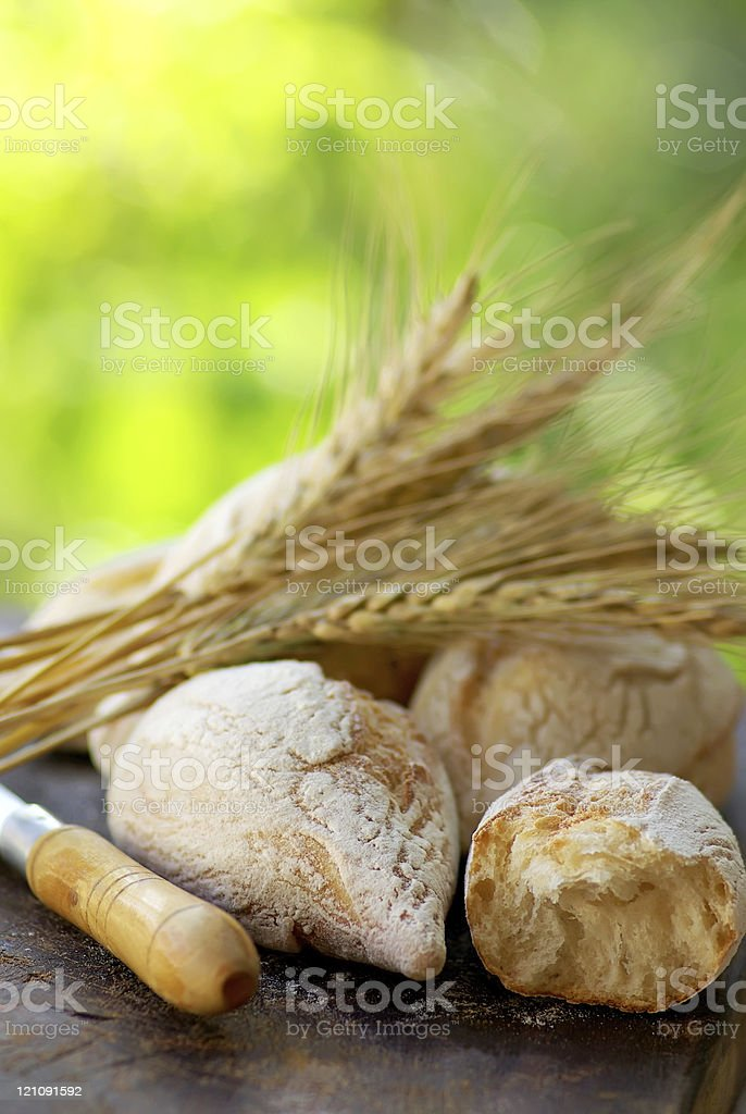 Portuguese bread and  spikes of wheat. royalty-free stock photo