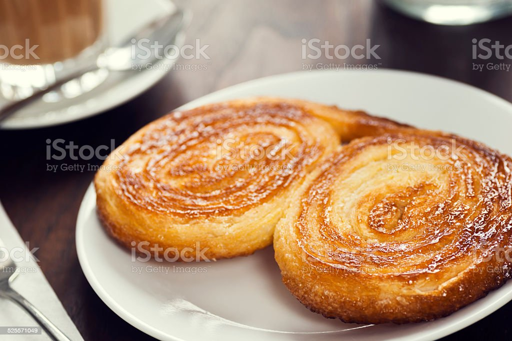 Portuguese Breakfast Palmier or Palmiere and Gal?o Coffee stock photo