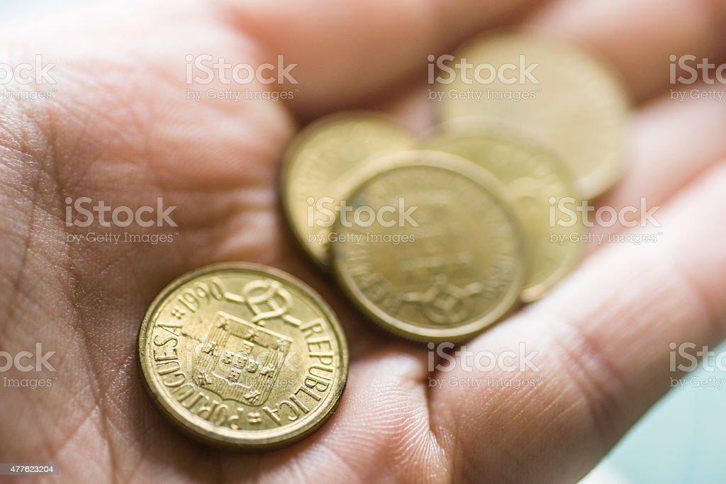 Portuguese Escudos in hand stock photo