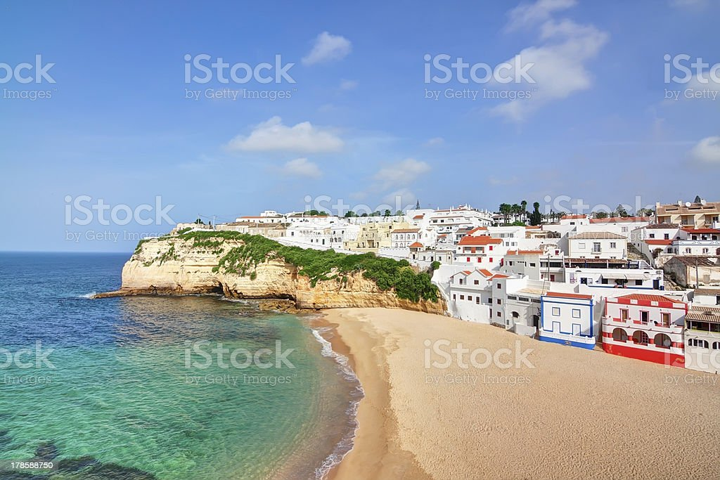 Portuguese villa in Carvoeiro beach with clear blue sea. stock photo
