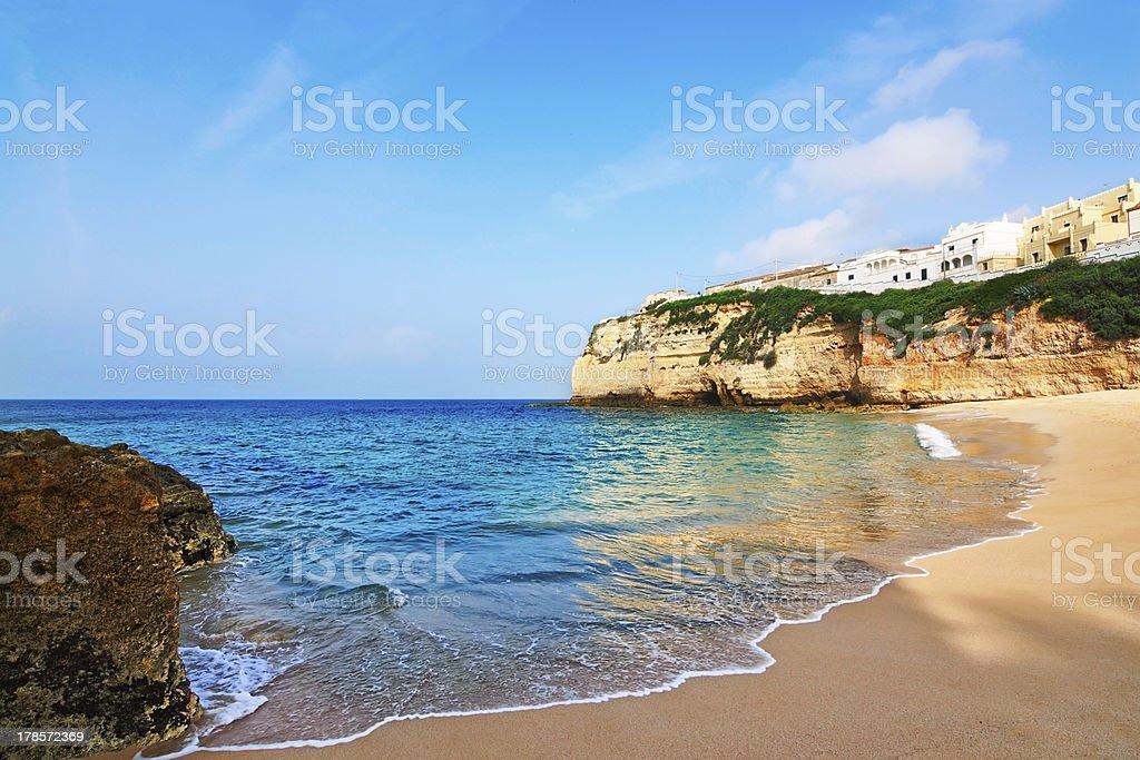 Portuguese villa in Carvoeiro beach with clear blue sea. Summer. royalty-free stock photo