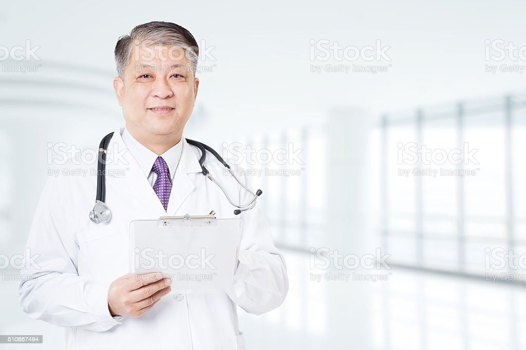 pose and gesture of old Asian man doctor stock photo