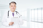 pose and gesture of old Asian man doctor