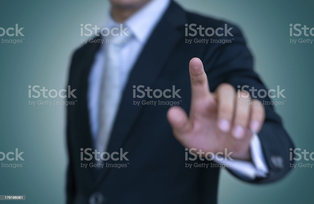 Businessman is Press a Button stock photo