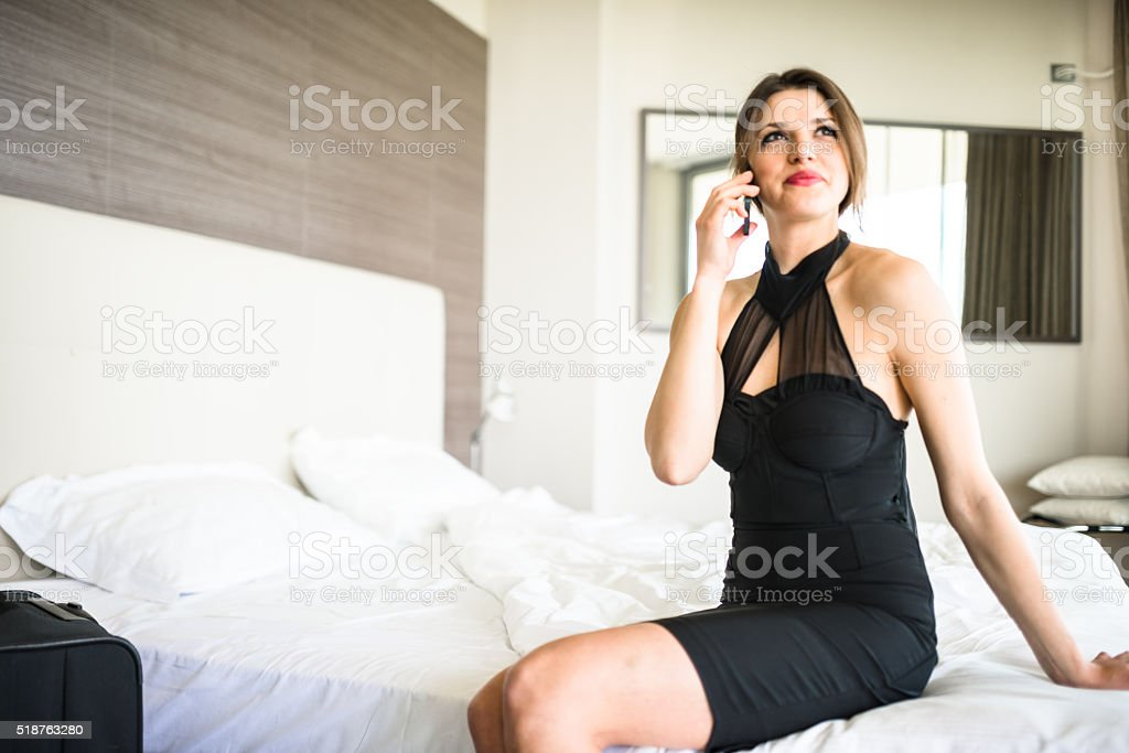 posh beautiful woman on the phone inside the hotel stock photo